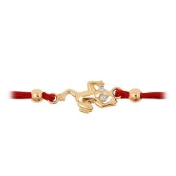 Браслет в виде лягушки из золота с фианитами и красным шнуром