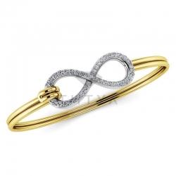 Жесткий браслет в виде знака бесконечности из золота двух цветов с бриллиантами